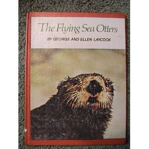 The flying sea otters George, and Laycock, Ellen Laycock