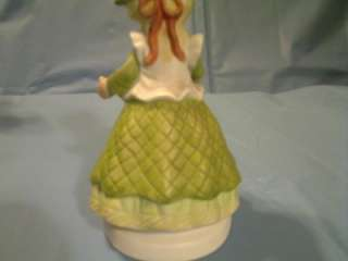 This MEGAN & FRIENDS GIRL WITH FLOWER POT FIGURINE HEARTLINE is in