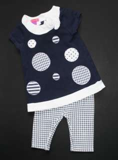 blue with white polka dots short sleeve tunic. Features striped, polka