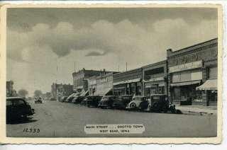 IOWA 1930s CARS DOWNTOWN MAIN STREET SCENE VINTAGE POSTCARD GROTTO IA