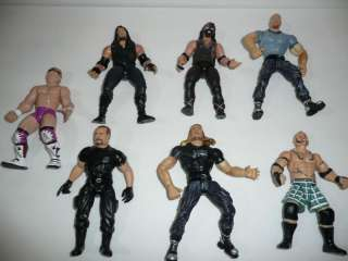 Lot of 7 WWE Wrestling 1990s Action Figures Toys JAKKS