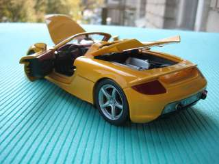 Porsche Carrera GT yellow Cararama Diecast Car Model 124 1/24