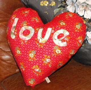 heart shaped love cushion by poppy valentine